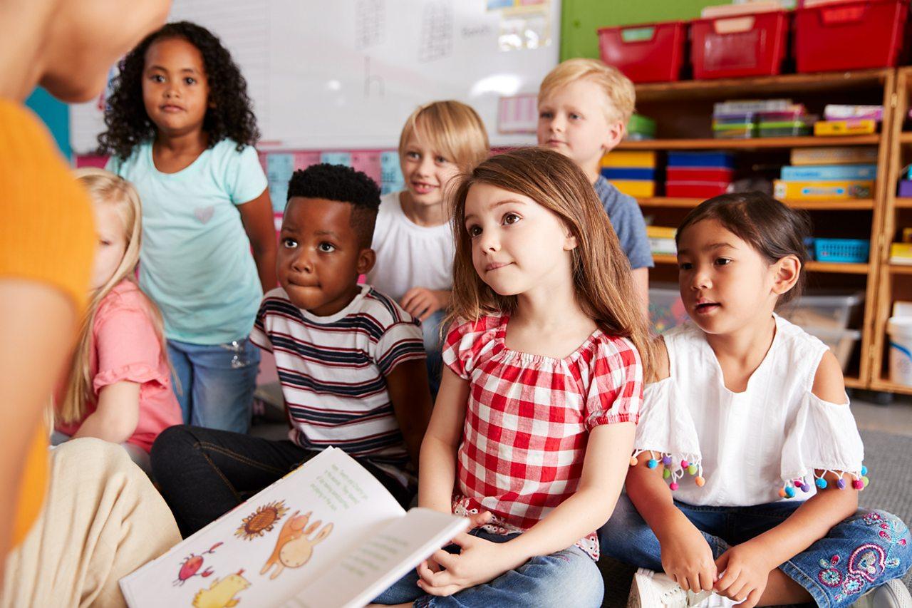 Children listen to a story in class