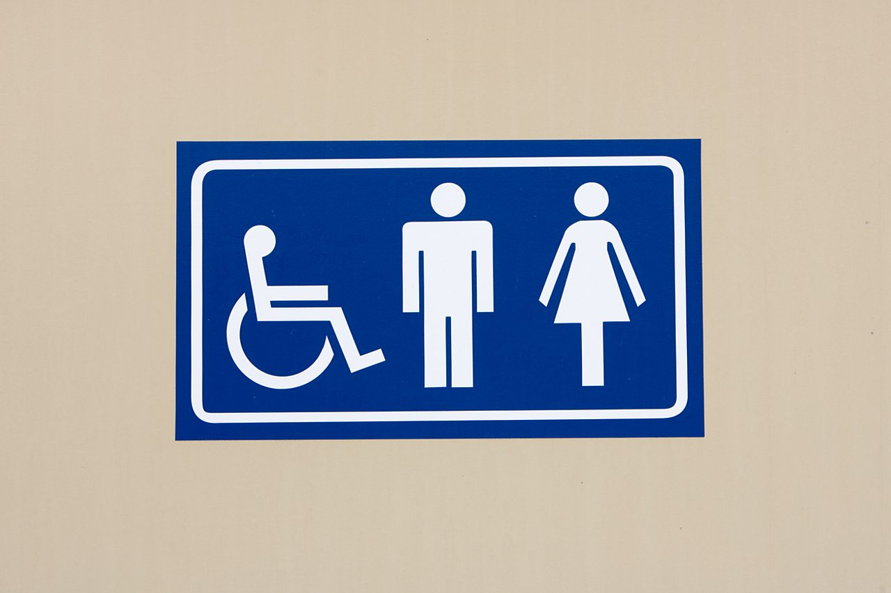 A sign for toilets