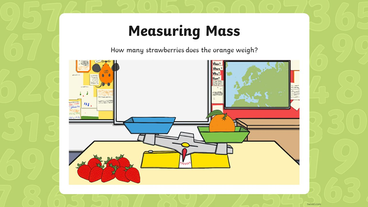 An orange weighs down one of the scales with eight strawberries on the table.