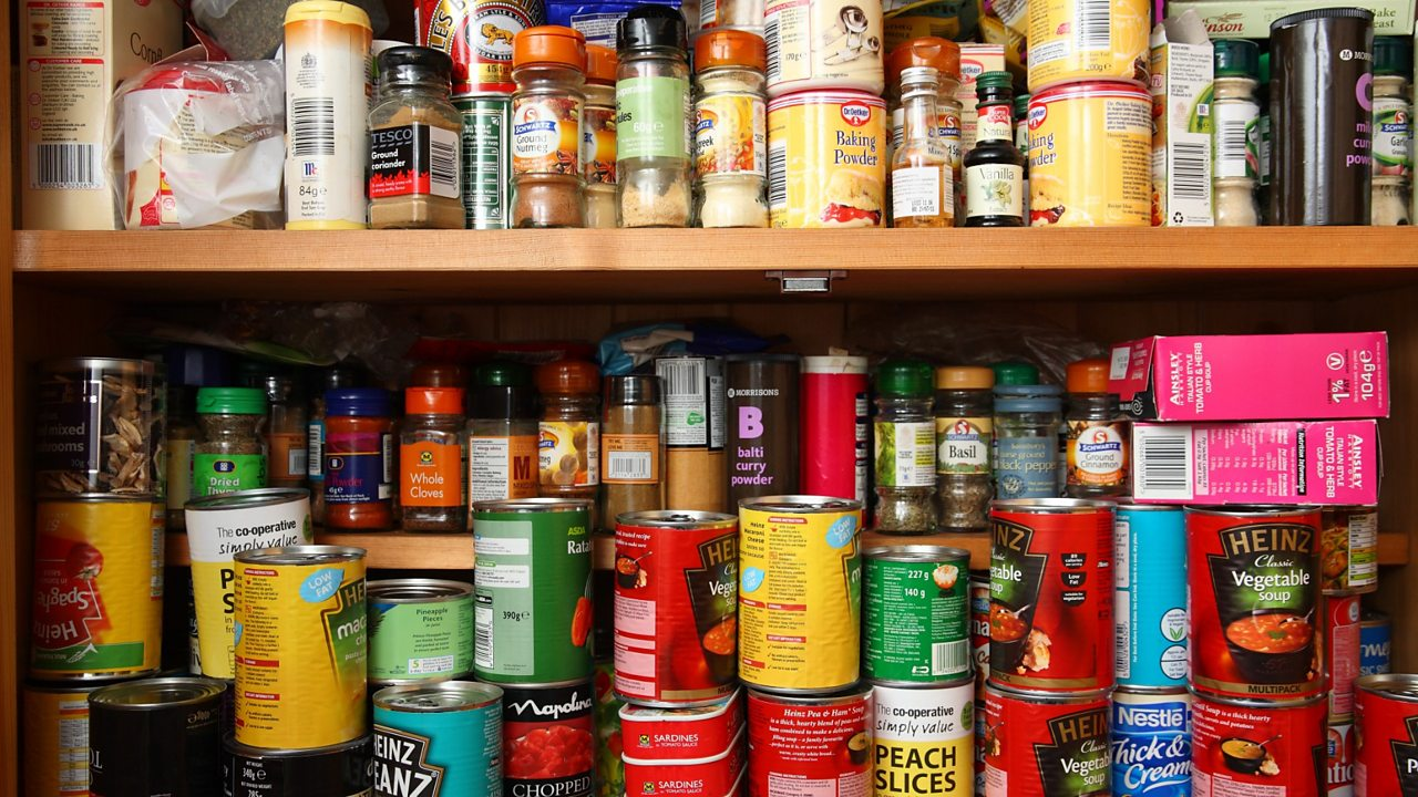 Food cupboard with packets and tins