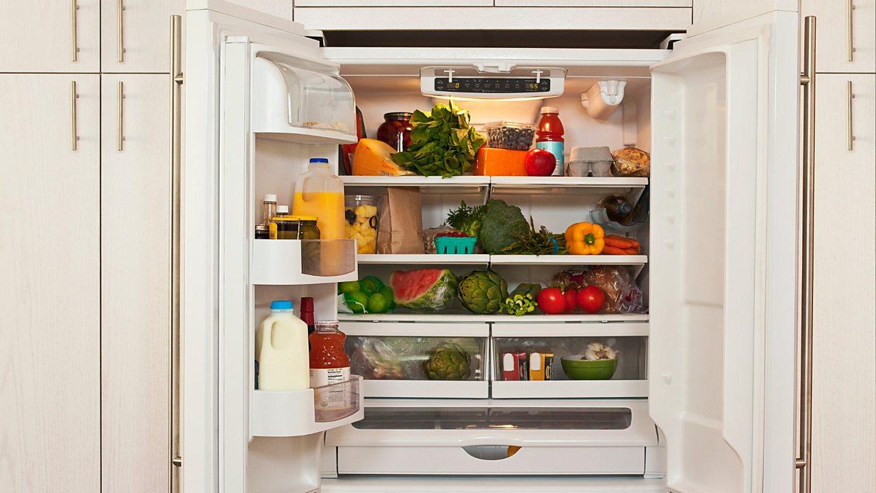 A fridge full of fruit and vegetables