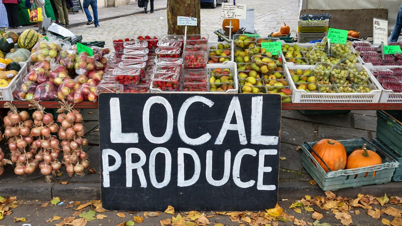 Local produce sign at a fruit and veg market