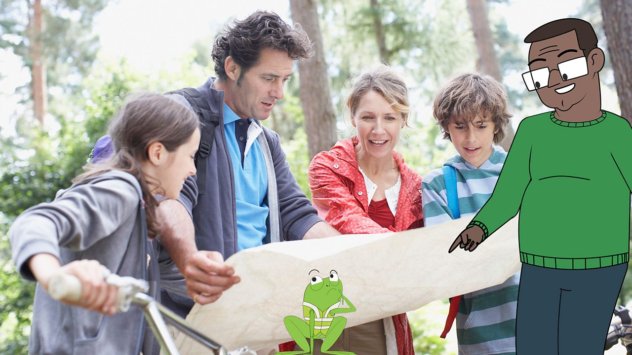 A family is looking at a map to find out where they are