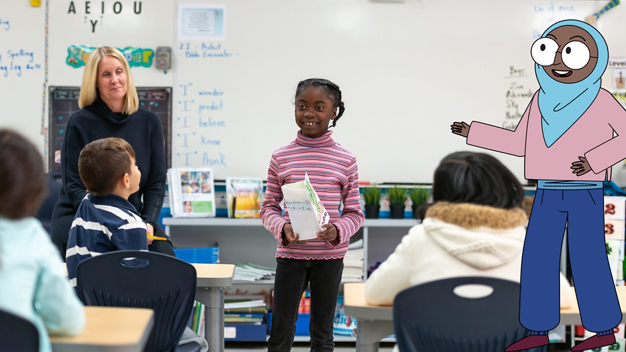 A girl presenting her sketches to the class