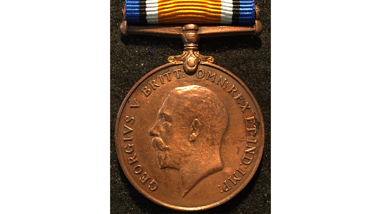 A photograph of a bronze British War Medal.