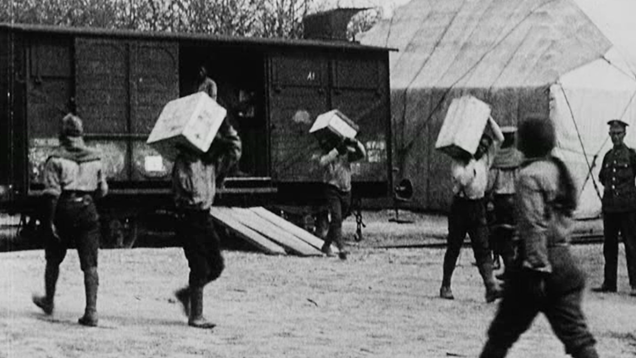 SANLC members carrying crates from cargo trains.