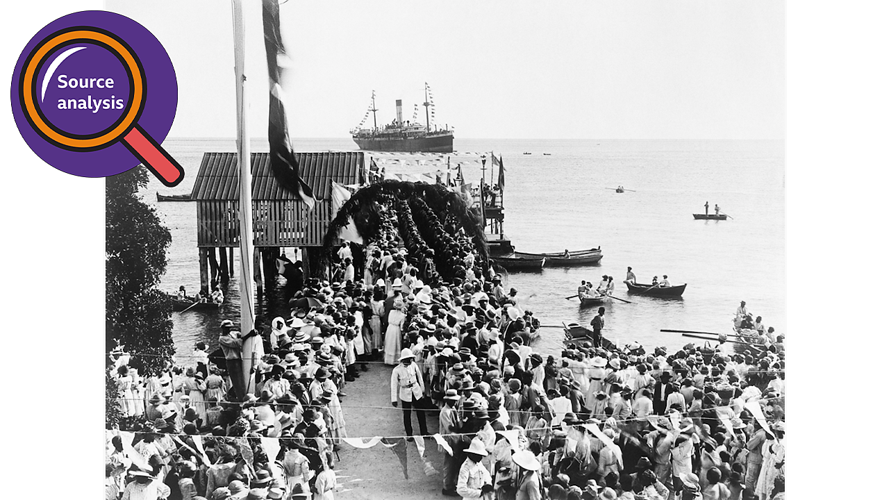 A crowd waiting at a St Vincent port for a ship transporting the BWIR to dock.