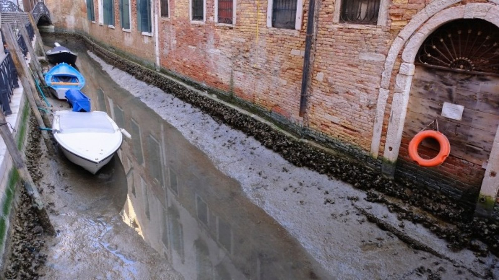 Low tides leave Venice canals dry
