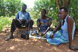 Sylvia and family listen to the radio programme