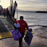 Noel McCurdy taking delivery of the post arriving from Ballycastle