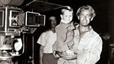 Photo of Alan Ladd with his son David on the film set of Shane.