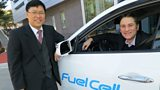 Dr Byung Ki Ahn with Gareth and the hydrogen fuel cell SUV