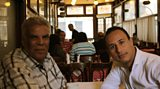 Author, Ibrahim Abdel Meguid stops for a coffee with Tarek Osman in Café Riche
