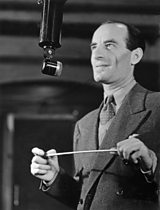 Bert Ambrose at the microphone in 1935