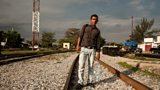 A migrant taking the rail route north through Mexico