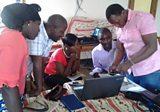 Training with Joseph on how to run farmer field groups for Radio Farmer