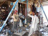 Waste pickers weighing scrap