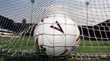 Football in goal net