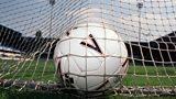 Football in goal net