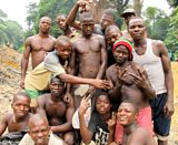 Liberian diamond miners near their excavations along the Moro River