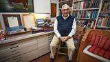 Ken Adam in his workroom (with James Bond archive files behind him)