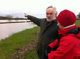 Farmer Stephen Watkins shows Sybil Ruscoe the extent of flooding on his land