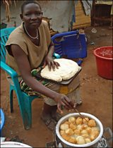 Helina Yoto sells doughnuts in the market in Maridi, South Sudan.