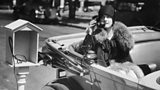 Woman in an automobile talking on the telephone