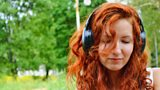 Woman listening to music with big headphones