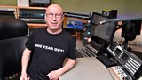 Ken Bruce wearing his One Year Out T-Shirt