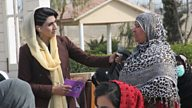 Handing the microphone to Afghan women