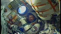 Tim Peake gives thumbs-up from Soyuz capsule