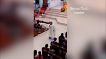 "Priest sings on ""hoverboard"" in church"