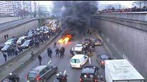 Fires burn at Paris taxi protest