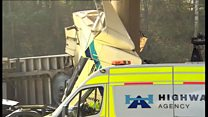 Lorry crashes through M40 central reservation