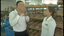 中国の工場、トランプ氏マスクで儲け狙う