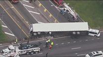 Multiple car crash leaves truck on the edge