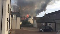 Fire crews tackle hotel blaze