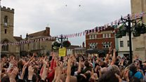 Abingdon celebrates Queen's 90th by throwing buns from the Town Hall
