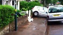 Birmingham flood lifts cars from road