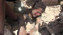 Boy rescued from Syria air strike rubble