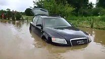 Cars left stranded after driving through Essex floods