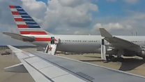Passengers evacuate plane at Heathrow