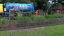 Sewage floods gardens after heavy rain