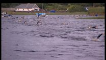 Hundreds of swimmers dive in for 6km river swim