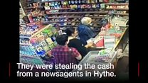 The woman and teenage boy are seen stealing the money