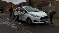 Girls wash cars to pay for dad's funeral