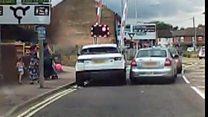 Driver jumps level crossing lights