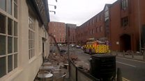 Wall collapses on to Glasgow street