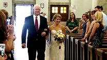 Bride walks down aisle by man with her father's heart